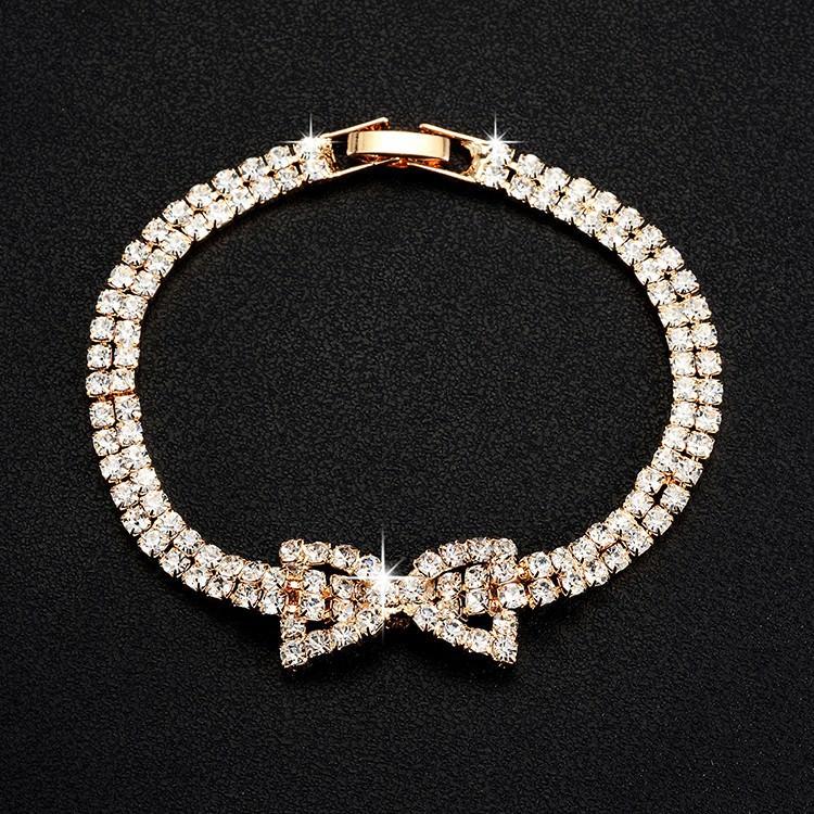 11518-51395dccc6d6ad0745f3577ac9511f19 Sparkling Rhinestone Chain Bracelet With Rhinestone Bow Accent