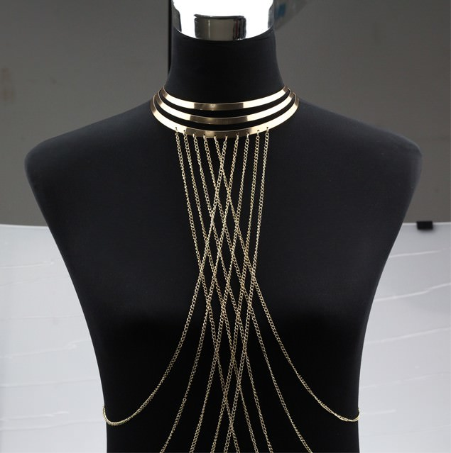This Gold Plated Choker Necklace With Long Body Chain Jewelry, in particular, is a choker and a body chain in one. It is made of gold plated three layered chokers. The chains are attached to the bottom layer and they form a lattice design on the cleavage part of the body.
