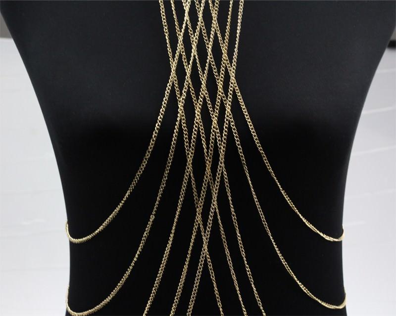 The Izabella Filigree Stone Pendant is a long rose gold station necklace with a clear quartz semi-precious stone.